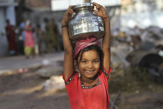 Girl Collecting water